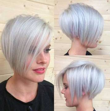 Peinado pelo corto gris tonos azulados claros capa larga ligera derecha